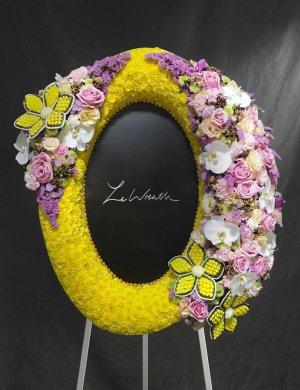 พวงหรีดดอกกุหลาบ ดอกคาร์เนชั่น สีเหลืองม่วง จากร้านเลอหรีด