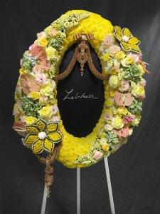 พวงหรีดดอกไม้สดสีเหลือง จากร้านเลอหรีดพวงหรีดดอกไม้สดสีเหลือง จากร้านเลอหรีด