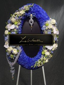 พวงหรีดดอกไม้สด ขนาดกลาง โทนสีน้ำเงินเข้ม สวยหรู จากร้านเลอหรีด